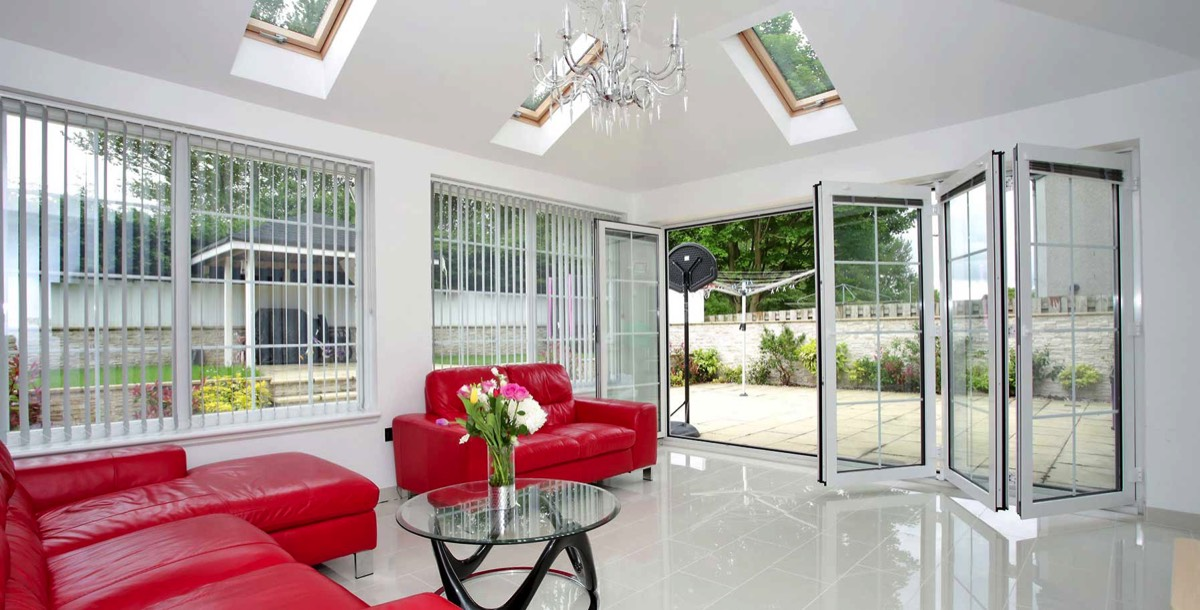 Modern and bright living room extension with bi-folding doors