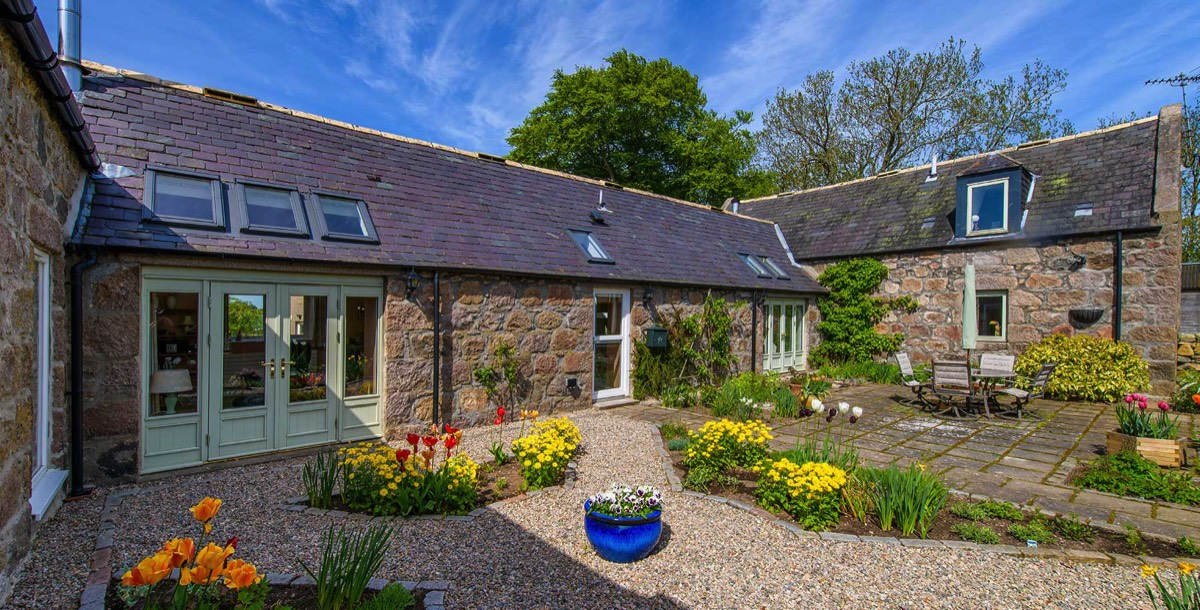 old steading with landscaped patio in Aberdeenshire